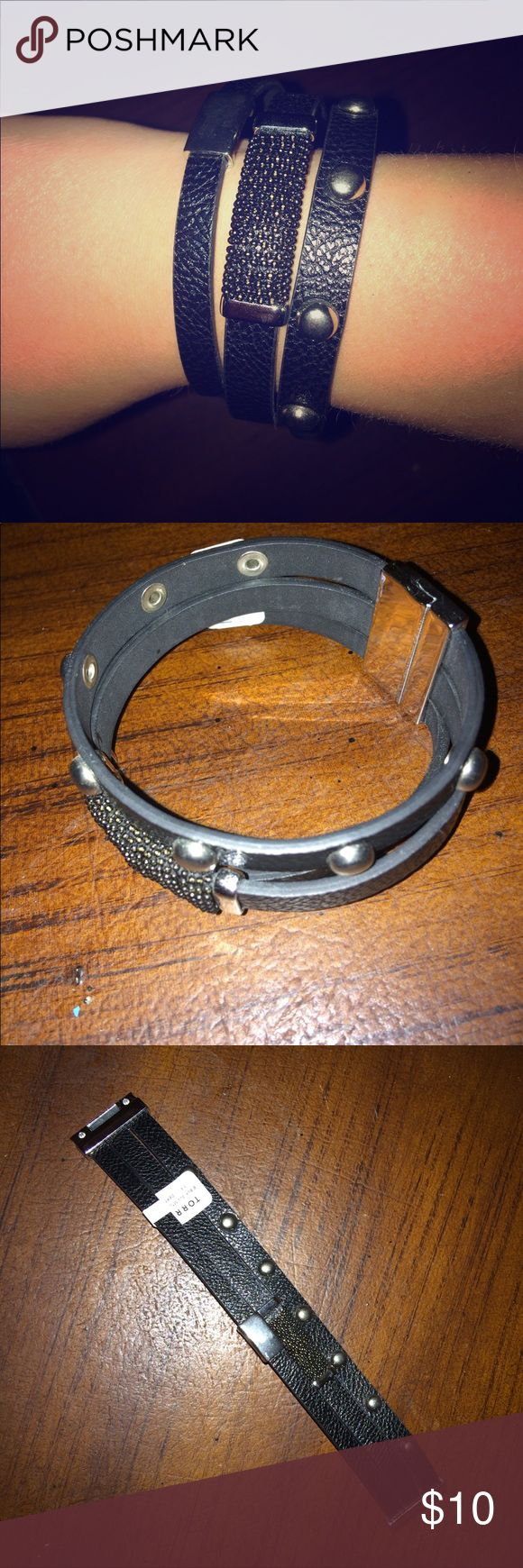 NWT Torrid Black/Silver Bracelet - size 3/4 New with tags, Torrid brand three strand wrap style bracelet with magnetic clasp.  Tag says size 3/4 so best for larger wrists.  No damage or signs of wear.  Ships from smoke free home!  👉🏻 Add to bundle with any single clothing item and this becomes a $5 add on!!! torrid Jewelry Bracelets