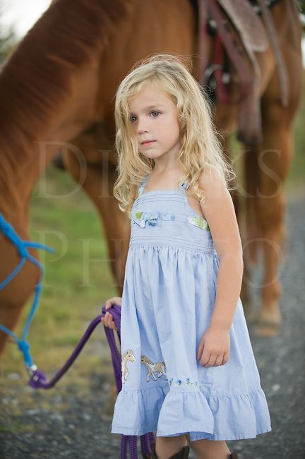 little girl equestrians | Little blonde girl leading her big horse down a country lane, three ...