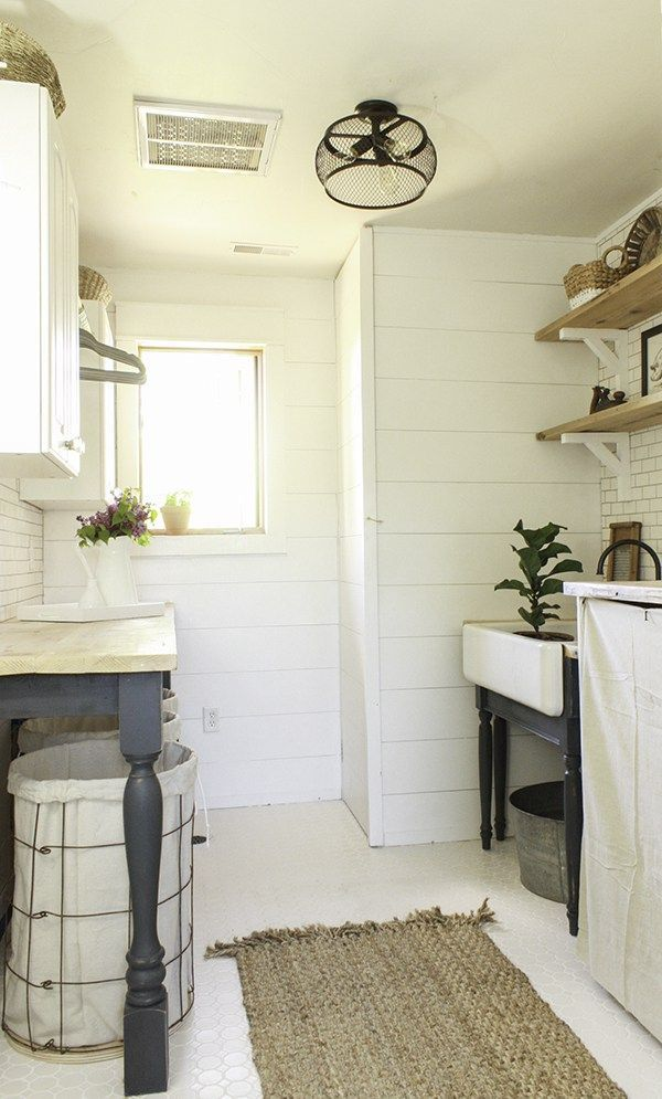 This farmhouse style laundry room is full of so much charm! From its shiplap walls, subway tile backsplash, and butcher block countertops, it is so dreamy!