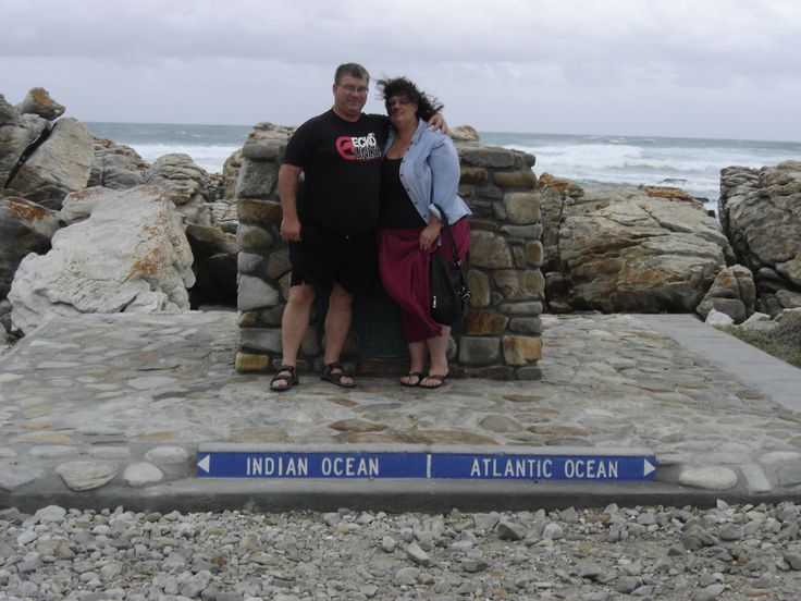 2.02.2012 - Hilary and I standing in the Indian and Atlantic oceans respectively, Cape Agulhas