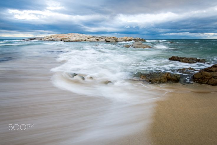 Side wave - Waves and stormy weather in an Autumn shot taken in Costa Rei, Southeast coast of Sardinia, Italy.