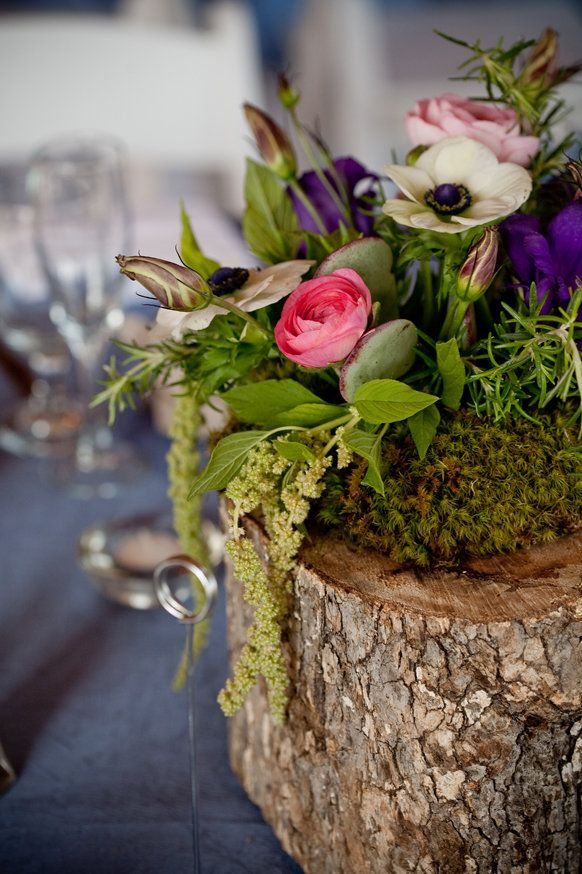 Tree Stump flower arrangement; hollow out tree stump and place a bowl in the hole with moss and flowers. Lovely for a buffet tablescape.
