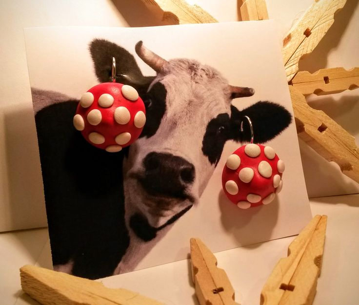 Polymer clay mushroom earrings. Even the cow can pull them off!