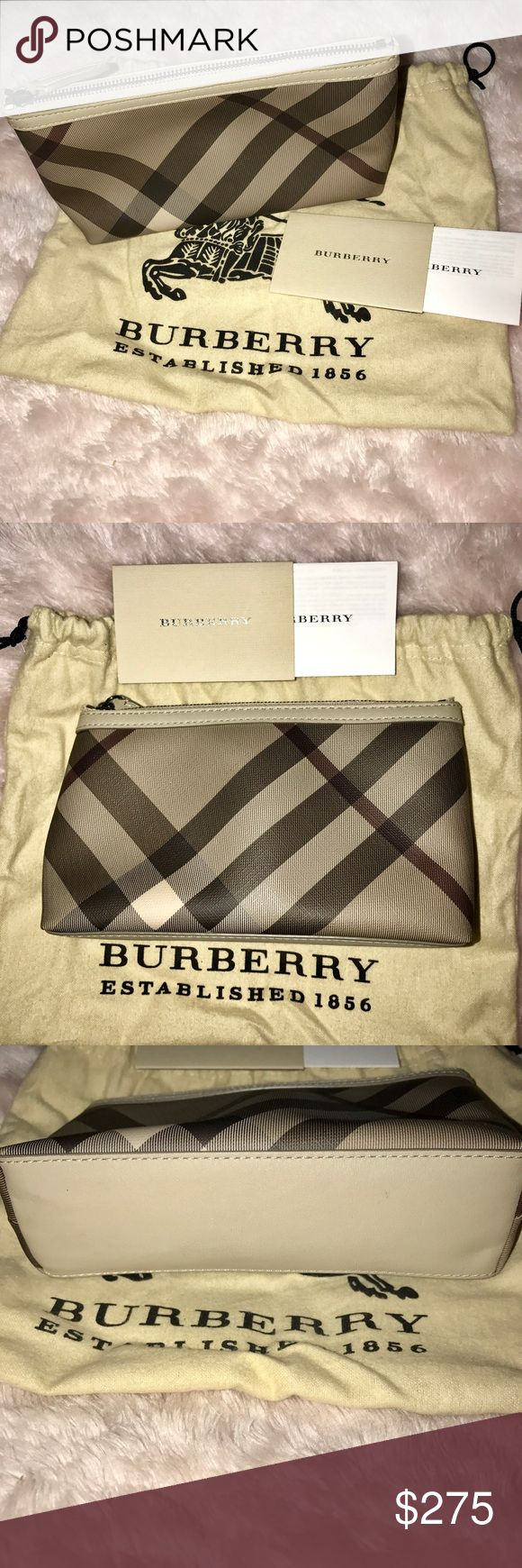 New Burberry Makeup Bag New with tags. Burberry classic plaid print  zippered makeup bag. Comes with original tags, & dust over. Burberry Bags Cosmetic Bags & Cases