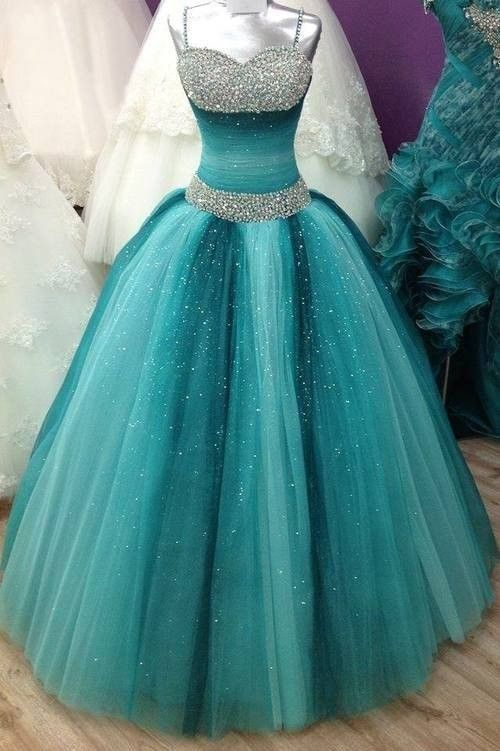 Ombre teal sleeveless ball dress. Dazzling beads are embellished on the spaghetti straps and top sweetheart bodice, tulle wraps around the midriff accentuating feminine curve, puffy skirt falls to the floor.