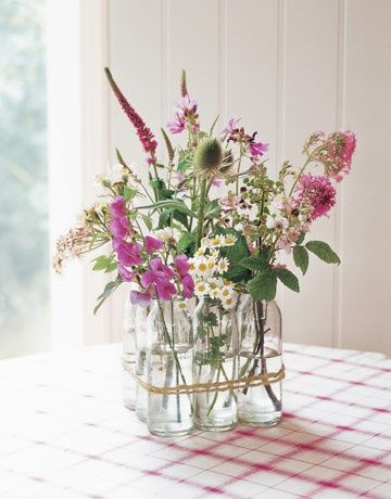 floral arrangement in vintage milk bottles - from Decorating with Flowers by Paula Pryke
