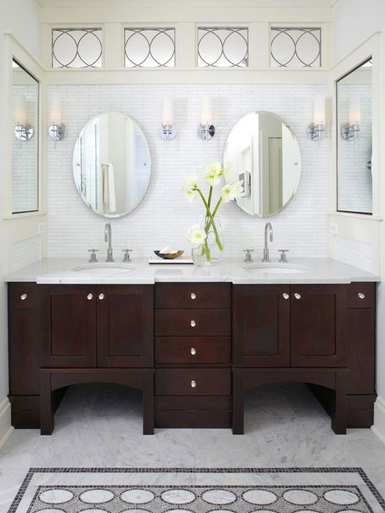dark vanity, white tile, oval mirrors