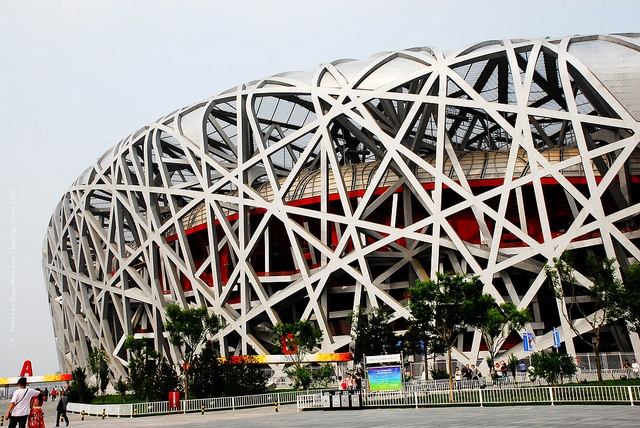 "Beijing National Stadium    The National Stadium of Beijing is located in the Olympic Green Area and cost US$423 million.    The design, which originated from the study of Chinese ceramics, implemented steel beams in order to hide supports for the retractable roof; giving the stadium the appearance of a ""Bird's nest"".    Photo by DiegoRios.com"