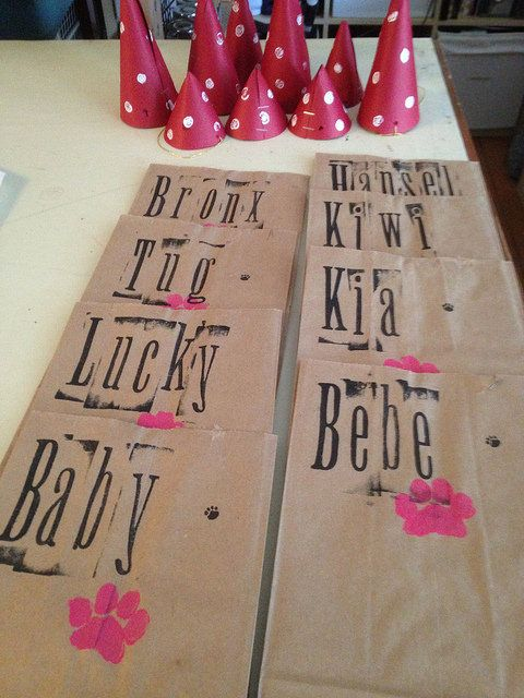 """""""I reused the small brown paper bags from the grocery store and used a stencil of a paw print that I made."""""""