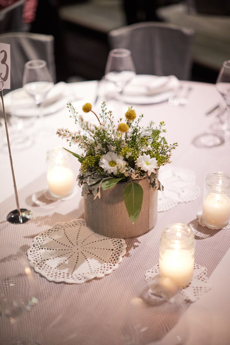 mr mrs, kraft detail, grey fabric cache pot, wild synthesis, yellow and greenery, distinto venue flowers, wedding dinner decoration, white canldes, glass candles, wedding decor, grey concept, craspedia, chamomile, marguerites, aktipis flowers