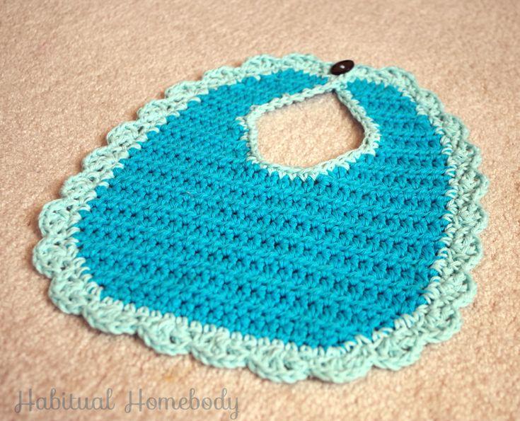 Crochet baby bib with scalloped border.