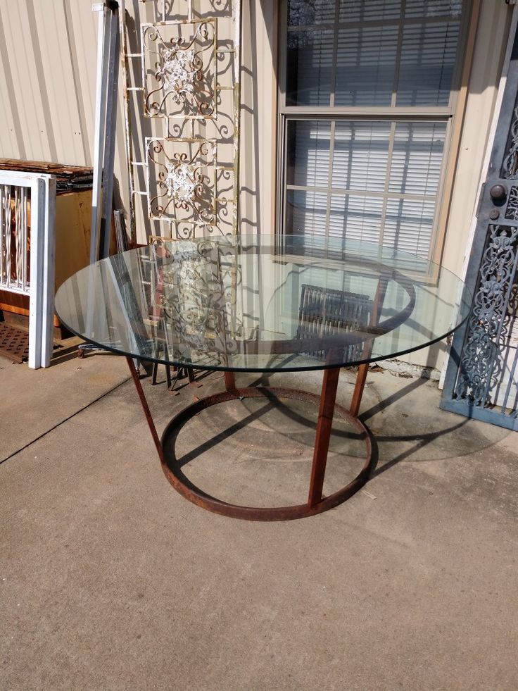 """SUPER SIDEWALK SPECIAL! LIMITED TIME ONLY:  THIS ONE-OF-A-KIND TABLE WAS BUILT EXCLUSIVELY FOR 2Brothers OUT OF SALVAGED ANTIQUE WAGON WHEEL RINGS.  THE 5' WIDE GLASS TOP IS 3/4"""" THICK! WE DO NOT HAVE ROOM TO EVEN DISPLAY IT IN OUR SHOWROOM, SO WE'RE OFFERING IT FOR A LIMITED TIME ONLY AT HALF PRICE! YES, 50% OFF RETAIL PRICE! OUR LOSS IS YOUR GAIN! CALL TODAY TO RESERVE THIS AWESOME UNIQUE TABLE FOR JUST $250!!!"""