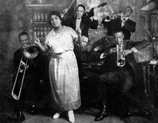 """Mamie Smith: First Recorded African-American Female Blues Vocalist:  Mamie Smith wasthefirst African American female to record blues songs in 1920 with her version of Perry Bradford's """"Crazy Blues,"""" and """"It's Right Here for You,"""" on Okeh Records. Smith's record went on to sell over a million copies in less than a year. Records made by African Americans during this"""
