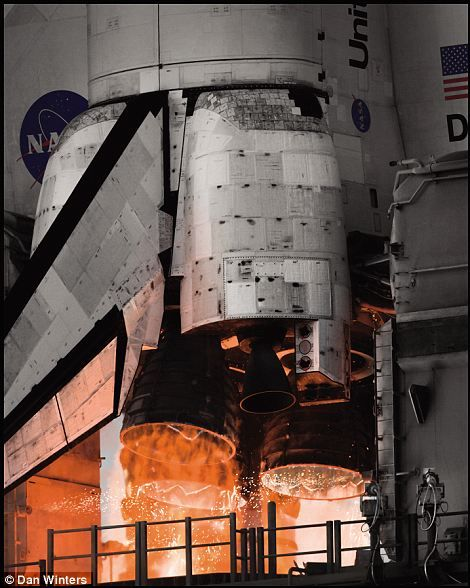 Space shuttle main engine start ... A million and a half pounds of thrust
