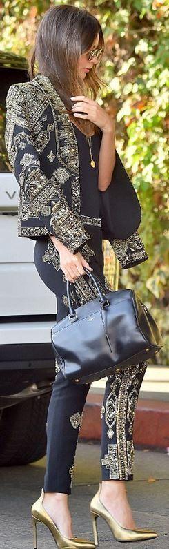 Miranda Kerr's gold print blazer, jewelry, embellished black pants, leather handbag, and gold pumps