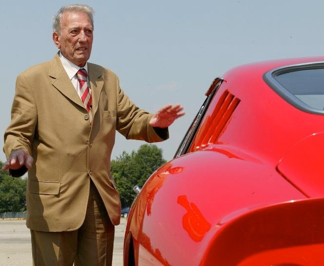 """Sergio Scaglietti, coachbuilder for Ferrari.  Ferrari coachbuilder Sergio Scaglietti passed away November 20, 2011 at 91 years of age.    Scaglietti gained Enzo Ferrari's trust and respect both through his bodywork and design skills and for providing a retreat for Dino Ferrari as a youth. Scaglietti is credited with the """"headrest"""" bump present on most racing Ferraris of the 1950s and 1960s, a design at first despised by Enzo but championed by Dino. The Ferrari 250 Testa Rossa."""