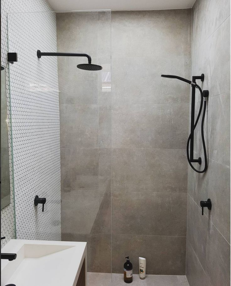 black tapware, concrete bathroom, concrete look bathroom, penny round mosaic tile, white feature mosaic tile, double shower, walk in shower,