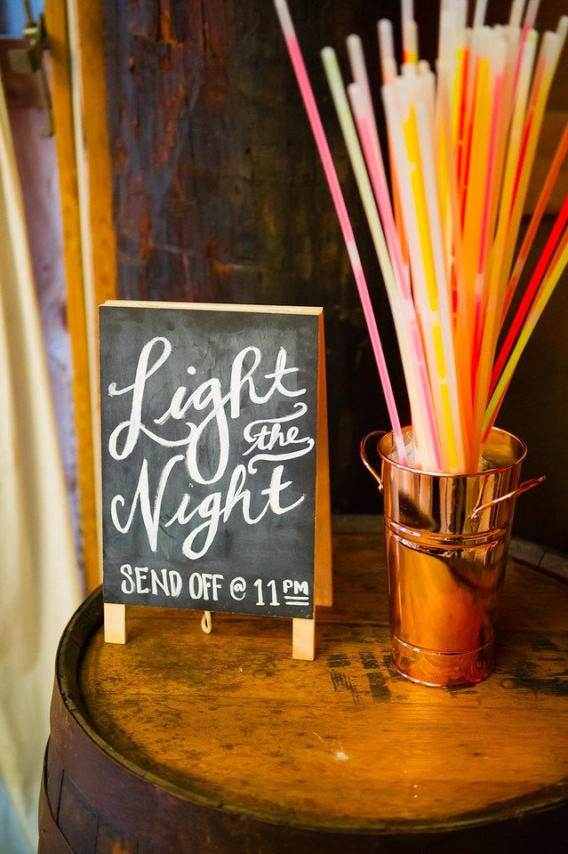 Light the Night DIY Wedding Chalkboard Sign designed by artists, Krystle Villanueva & Marjorie Pleta - Mark It. This was for the Bride and Groom Farewell Send Off with Glow Sticks. Photography by Glenn Orion. Visit kvillanueva.com.