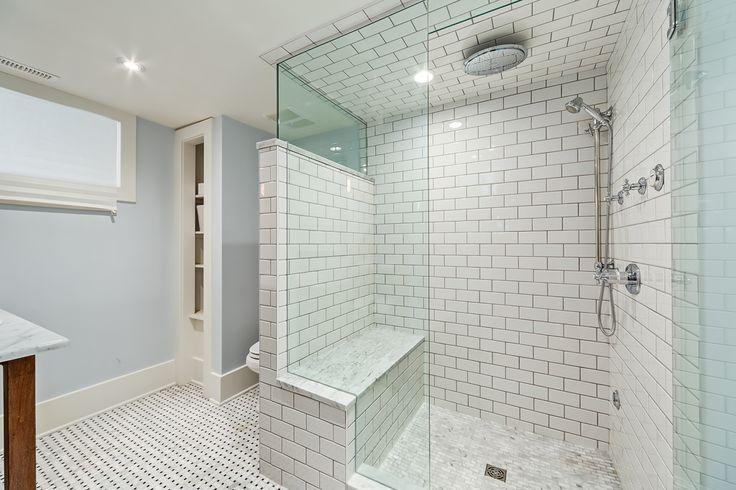 A custom bathroom by Kon-strux Developments  Subway tile design