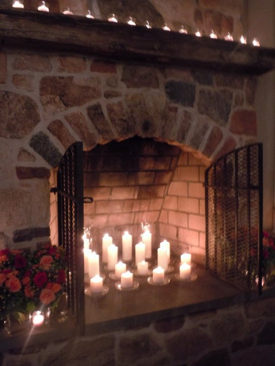 {candles in the faux-fireplace}