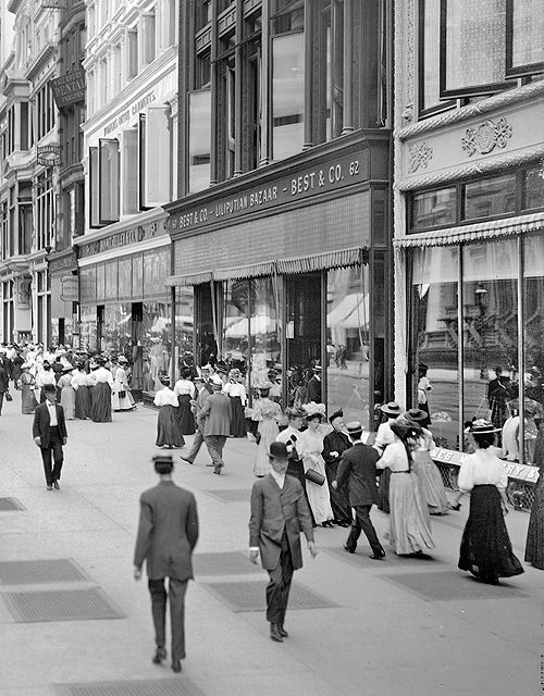 Enormously wide sidewalks and high storefront windows a NYC Trademark - many building still have the beautifully detailed stonework facades. New York circa 1905. West 23rd Street.