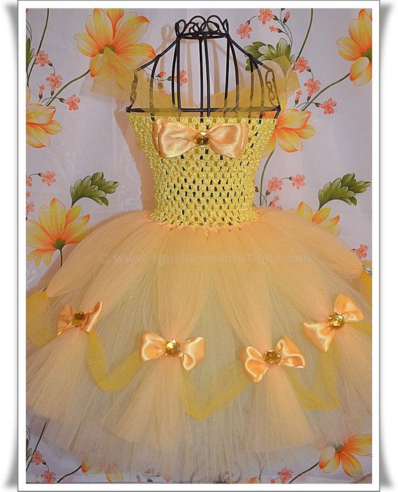 Princess Belle Inspired Tutu Dress by 4GPrincessBowtique on Etsy, $74.50 Love the bows between tulle