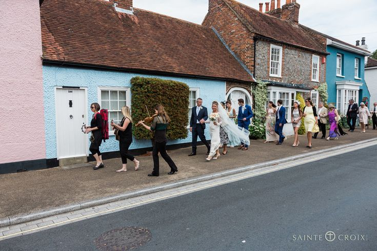 The bride and groom were escorted to their marquee wedding reception by the talented http://www.thebossardquartet.co.uk/