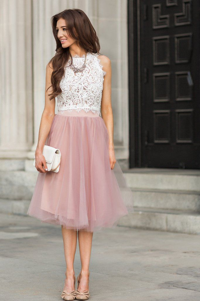This sleeveless lace tank paired with a blush tulle skirt is a stylish choice for your wedding rehearsal.
