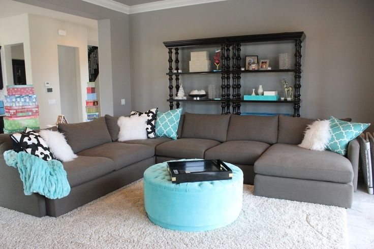 tiffany blue and grey family room...love that sectional... I'm normally not a fan of Tiffany blue but it works in this living room