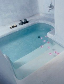 a bathtub that is sunk into the floor. It's like a pool in your bathroom, amazing!!! I WANT THIS!!!!!