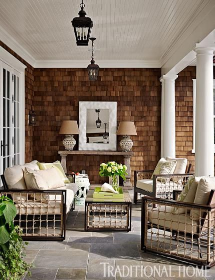 Rope-accented patio pieces look fresh and exciting on the shingled patio. - Traditional Home ® / Photo: Lucas Allen / Design: Andrew Howard