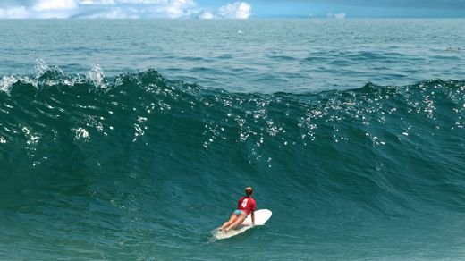 Girl on surfboard heading out and looking for the eight wave #surfing #surfer #wave #boarding #paddle #surfergirl #kilroy