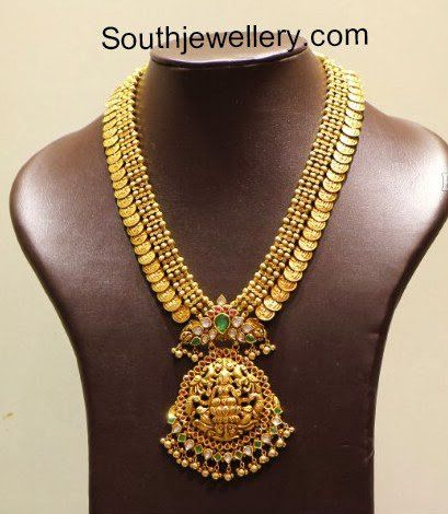 Beautiful Lakshmi Kasula peru with Nakshi pendant studded with kundans, emeralds and rubies. Related PostsKasula Peru with Lakshmi PendantSimple Gold Kasu Mala2 in 1 Kasu Haram and VaddanamLakshmi Kasu MalaUnique Gold Lakshmi Kasu MalaRam Parivar Kasu Haram