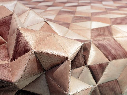 Elisa Strozyk has created a unique daybed featuring a quilted cover made of wood, continuing her exploration of experimental textile design using wood as a material for fabrics.