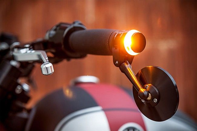 Detail of bar-under hanging mirror and 360-degree glowing handlebar turn signal | Triumph Bonneville By Macco Motors