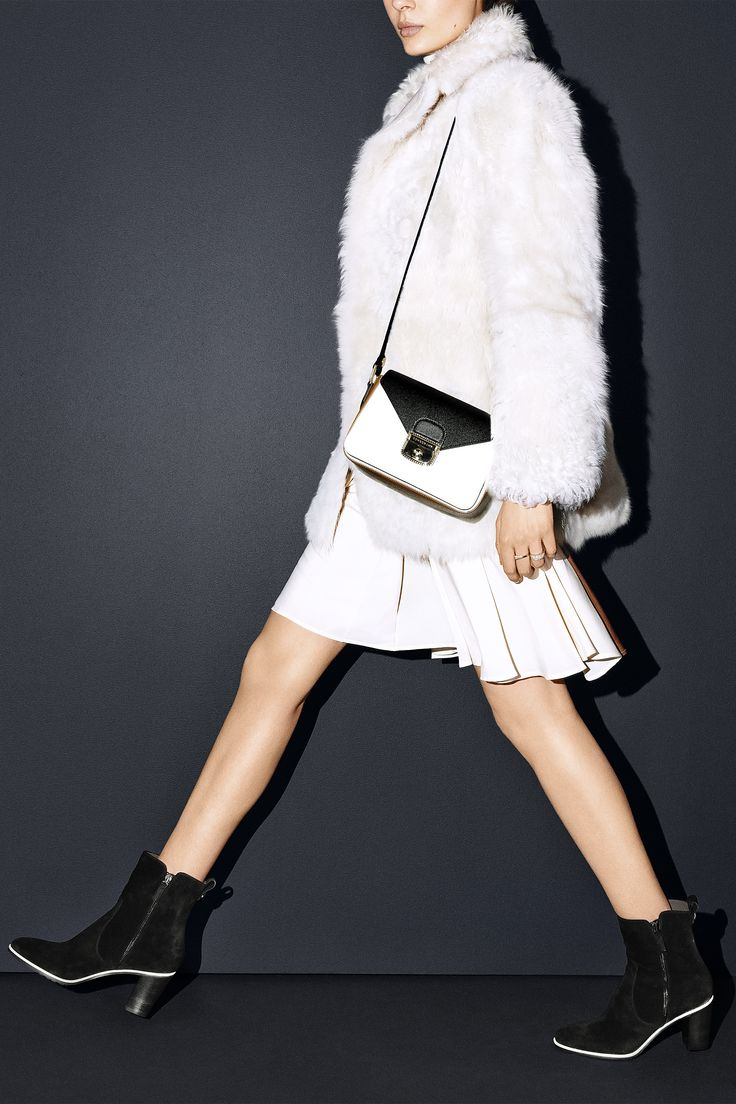9) THE FURRY JACKET This arctic white show stopper lets you keep your cool. 10) THE ANKLE BOOT Rejoice—sturdy, versatile heels are It this season. Hilfiger Collection jacket, $1,900, sweater, $460, and skirt, $490, 212-223-1824; Longchamp bag, $650, and boots, $675, longchamp.com; Graziela Gems rings, $1,500, grazielagems.com;   - HarpersBAZAAR.com