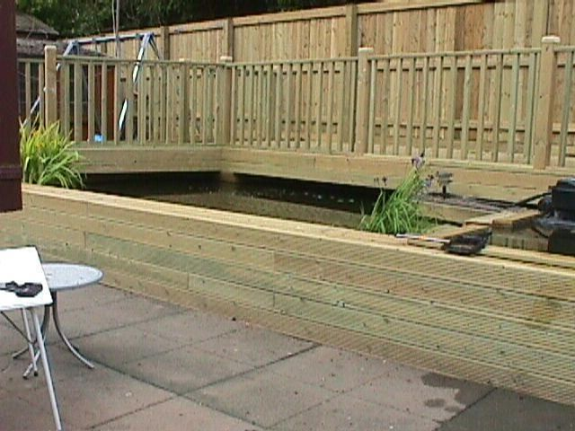 Decking Over Pond With Hand Rail And Closeboard Fence Jpg