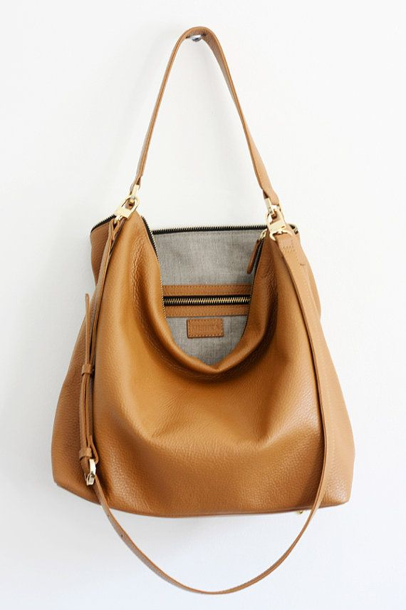 This camel brown leather hobo bag is made from high quality pebbled Italian leather and is lined with soft natural linen. The bag is soft and slouchy.