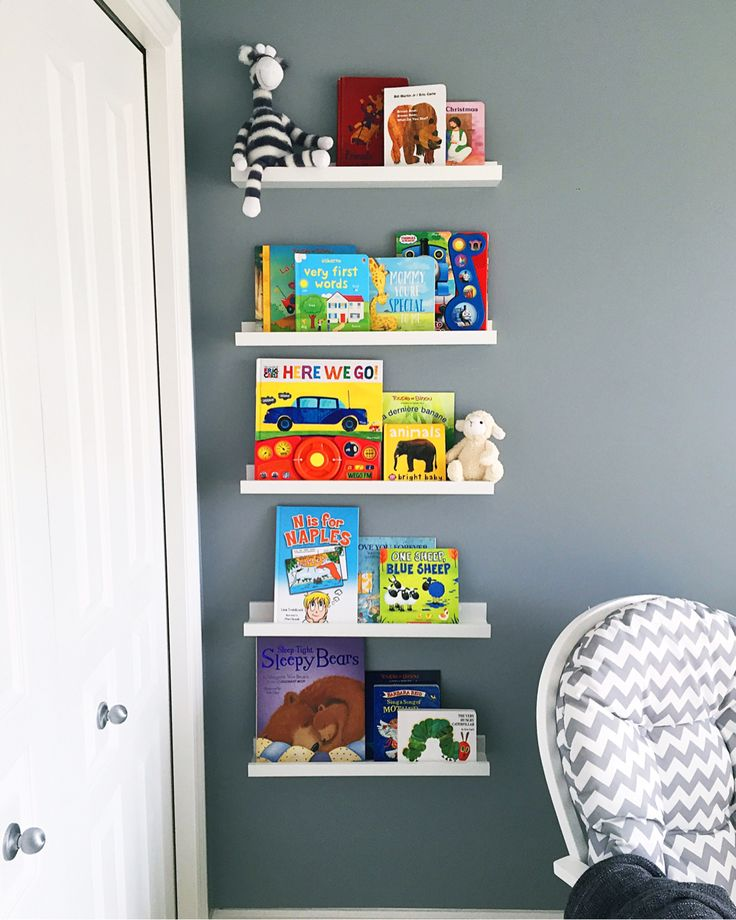 """IKEA Ribba picture ledges to create a floating """"bookshelf"""" in the nursery. Makes for easy access for you and baby (when they can stand) and also displays books as pieces of art. So easy to do!"""