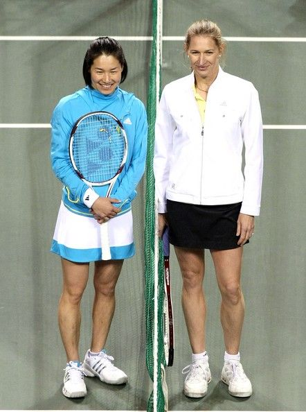 Kimiko Date (left) of Japan and Steffi Graf of Germany pose for photographers before their 2008 Dream Match at Ariake Colosseum on March 15, 2008 in Tokyo, Japan. Kimiko defeated Steffi by a final of 6-2, 6-3.