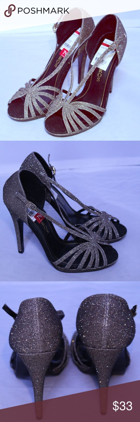 Carlos Santana Metallic Dressy Sandals 7.5 Sparkly strapped sandals perfect for a party. New with tags. Fabric upper, leather sole. Carlos Santana Shoes Sandals