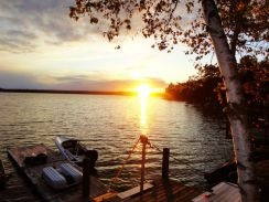 Canada - Ontario - Kawartha Lakes. We feature a beautiful lakefront setting overlooking a sandy bottomed weedless beach. You will enjoy a gorgeous view of the sunset when Mother Nature provides it, a 40 foot sunning dock on the water as well as a 40 foot boat dock.