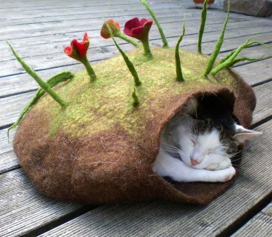 These incredible pieces of functional art are called Katzenhoehle, or cat caves. Each is handmade of felted wool by German artist Dornroeschen Filzunikate. There are several styles and sizes to choose from and the caves are apparently washable. They look so delicate, but very cozy, too.  Available via what appears to be the German version of Etsy, DaWanda.