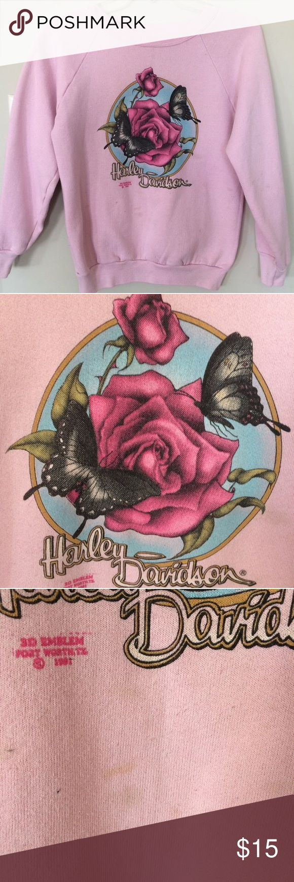 Harley Davidson sweatshirt Worn Harley Davidson pink floral sweatshirt. Love this so much, just too small. Slight stain on bottom. Size small but fits like an xsmall. Tops Sweatshirts & Hoodies