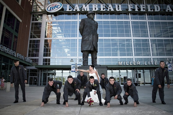 One of my favorite wedding photos of all time. Taken outside Lambeau Field in Green Bay, Wisconsin. Go Pack!