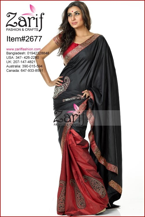 Nice combination of Maroon and Black silk saree with paisley motif embroidery work on body, katan border. comes with blouse piece