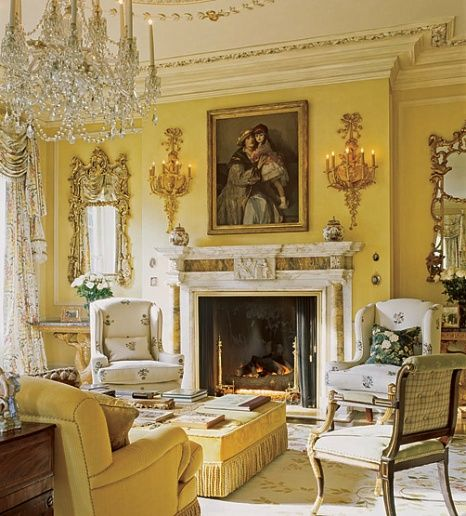 I would dress down the curtains a bit, and put the Chinoiserie blue and white chairs in this living room.   All golden yellow puts me to sleep.   Yet I love the disposition of this room