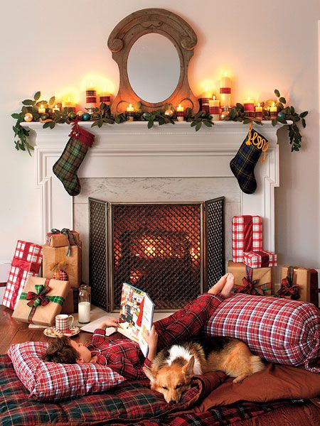 Classic plaid pillows, blankets, and sleeping bags create a cozy palette on the floor for cold nights by the fire. Plaid ribbon-wrapped candles, stockings, and even gift wrap create a festive theme in this home. (Photo: Laurey W. Glenn)