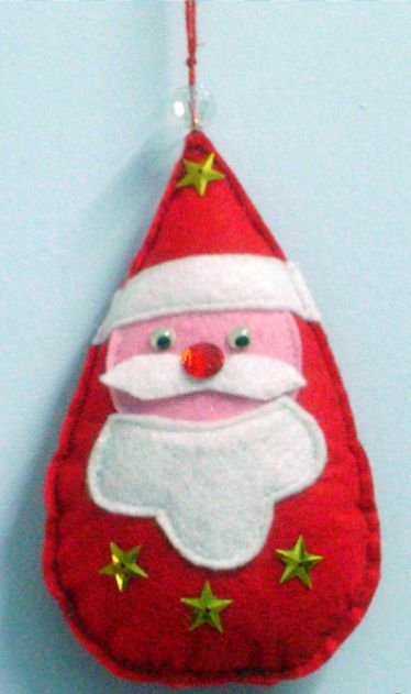 Sewn Santa Christmas Ornament Craft - Use this charming free sewing pattern to make an itty bitty Santa craft for your tree.