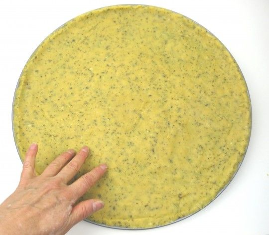 """Paleo Pizza Dough for 12"""" and 16"""" pizzas. Here's a quick and delicious gluten-fee, grain-free pizza crust. It has a slightly crispy texture with a rich flavor of garlic and herbs. It's a snap to make, as this pizza dough recipe has no yeast. This saves time, so you can mix it, press it in the pan, and use it! I prefer a no-yeast pizza crust because it saves a lot of time."""